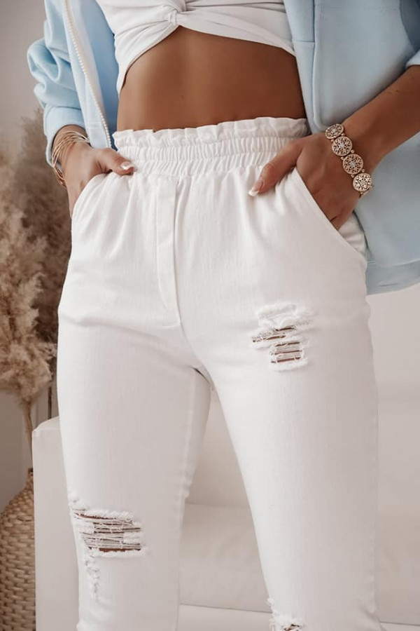 Spodnie jeans z dziurami 1