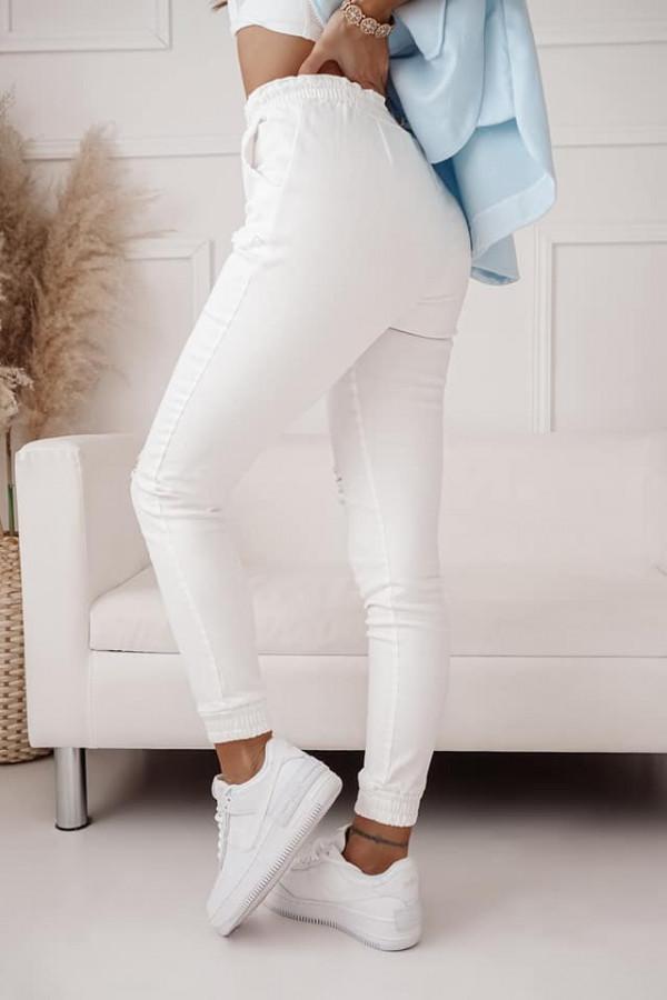 Spodnie jeans z dziurami 2