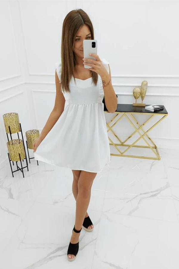 Elegancka sukienka z delikatną, dziewczęcą falbanką
